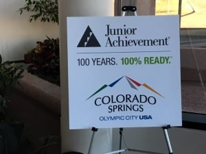 A sign celebrating Junior Achievement at 100 years and being 100% ready